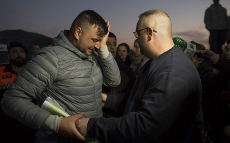 Jose Rosello (L), the father of Julen who fell down a well, cries as rescue efforts continue to find the boy in Totalan in southern Spain on 16 January 2019. Picture: AFP