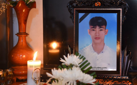 A portrait of 20-year-old Nguyen Dinh Luong, who is feared to be among the 39 people found dead in a truck in Britain, is kept on a prayer altar at his house in Vietnam's Ha Tinh province on 29 October 2019. Picture: AFP