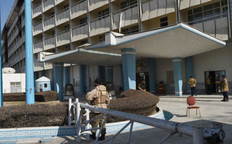 Afghan security personnel with a private company stand guard at the Intercontinental Hotel in Kabul on 23 January 2018, following an attack. Picture: AFP