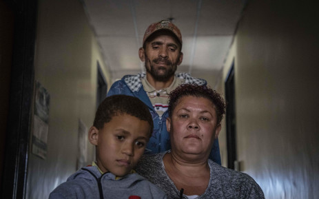 Elize Marcha O'Brien with her son and partner. O'Brien is a victim of marriage fraud. Her case is one of the many that is being taken up by the Wits Law Clinic against the department of home affairs. Picture: Abigail Javier/EWN