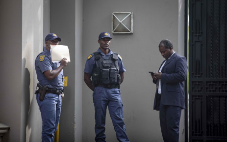 FILE: Police and Asset Forfeiture Unit (AFU) officials raid the Gupta compound for assets to the value of R250 million. Picture: Thomas Holder/EWN