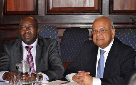 Newly appointed Finance Minister Nhlanhla Nene alongside former Finance Minister Pravin Gordhan. Picture: GCIS.