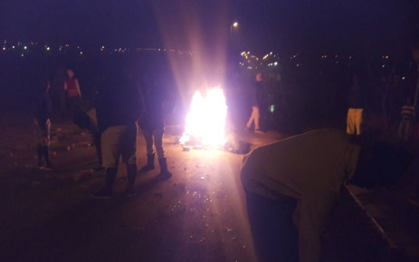 Diepsloot residents have blocked roads with burning tyres and debris. Picture: Koketso Motau/EWN.