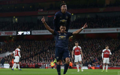 8452cecf321 Chilean forward Alex Sanchez and Jesse Lingard celebrate a goal during Manchester  United s heavyweight FA Cup