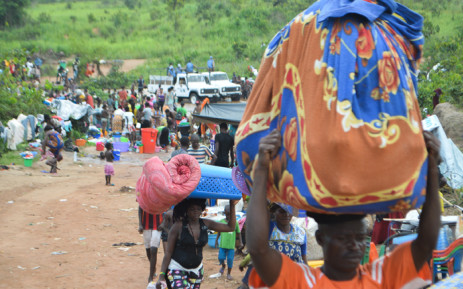 Congolese migrants who were living in Angola gather near the Congolese border town of Kamako, on 12 October 2018, after returning to their country following a security crackdown by Angolan authorities. Picture: AFP