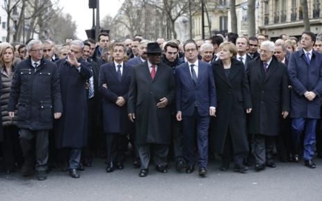 French President Francois Hollande is surrounded by head of states including (first row,LtoR) European Commission President European Commission President Jean-Claude Juncker, Israel's Prime Minister Benjamin Netanyahu, Former French President Nicolas Sarkozy, Mali's President Ibrahim Boubacar Keita, Germany's Chancellor Angela Merkel, Palestinian President Mahmoud Abbas and Italy's Prime Minister Matteo Renzi as they attend the solidarity march (Marche Republicaine) in the streets of Paris January 11, 2015. Picture: AFP