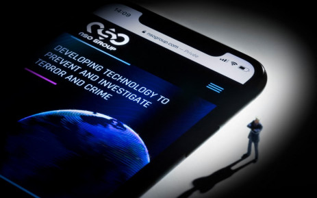 This studio photographic illustration shows a smartphone with the website of Israel's NSO Group which features 'Pegasus' spyware, on display in Paris on July 21, 2021. Picture: AFP