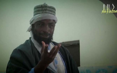 A screengrab taken on 9 November, 2014 from a new Boko Haram video released by the Nigerian Islamist extremist group Boko Haram and obtained by AFP shows the leader of the Nigerian Islamist extremist group Boko Haram, Abubakar Shekau preaching to locals in an unidentified town. Picture: AFP.