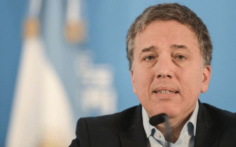 In this file photo taken on 17 April 2019 Argentinian Economy Minister, Nicolas Dujovne, talks during a press conference at the presidential residence in Olivos, Buenos Aires. Picture: AFP