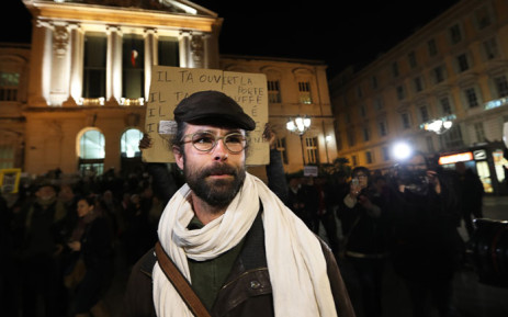 French farmer Cedric Herrou (C) leaves the courthouse of Nice, southeastern France, on January 4, 2017, after his trial for allegedly assisting migrants to enter and remain illegally in France. Picture: AFP