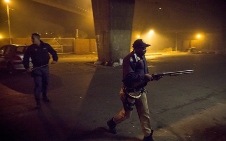 FILE: Police try to restore order in the Johannesburg CBD during a flare-up of xenophobic violence on 17 April 2015. Picture: Thomas Holder/EWN.