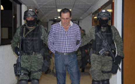 "FILE: A handout picture shows Hector Beltran Leyva, leader of the Beltran Leyva's drug cartel, during a press conference at the headquarters of the General Attorney in Mexico City, on 1 October, 2014 after Beltran Leyva, aka the ""H"", was arrested in San Miguel de Allende, Guanajuato State, Mexico. Picture: AFP"