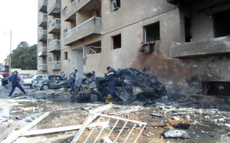 FILE: The site of a car bomb attack outside a military intelligence building in Egypt's canal city of Ismailia on 19 October. Picture: AFP.