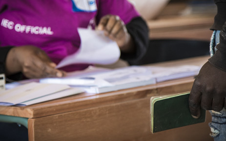 FILE: IEC officials process voters at a voting station. Picture: Thomas Holder/EWN.