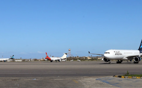 In this file photo taken on April 08, 2019 Grounded air-planes sit on the tarmac at Mitiga International Airport in the Libyan capital Tripoli. Rocket fire on August 11 hit the Libyan capital's sole functioning airport, violating a temporary truce between the unity government and forces loyal to strongman Khalifa Haftar, airport authorities said. Picture: AFP