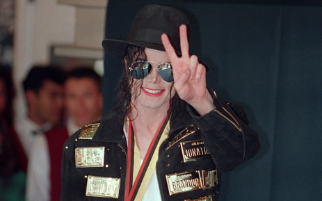 FILE: US pop star and entertainer Michael Jackson flashes the victory sign after receiving the lifetime achievement medal from the Guinness book of records in Hollywood on 19 May 1993. Picture: AFP