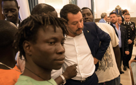 FILE: Italy's Interior Minister Matteo Salvini (C) talks with a delegation of foreign farm labourers in the prefecture of Foggia, southern Italy, on 7 August 2018, a day after a van smashed into a lorry killing 12 migrant agricultural workers on board. Picture: AFP