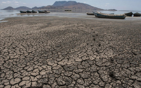 This file photo taken on 18 October, 2018 shows wooden boats lying on the dry lake bottom at the dried inland Lake Chilwa's vacated Kachulu Harbour in Zomba District eastern Malawi, on 18 October, 2018. Picture: AFP.