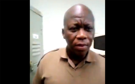 A video screengrab of a Correctional Services official who was caught on camera allegedly drunk at work.