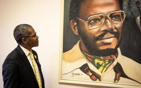 Velenkosini Hlabisa looks on at Buthelezi's portrait at the IFP's offices in Ulundi, KwaZulu-Natal. Picture: Xanderleigh Dookey/EWN