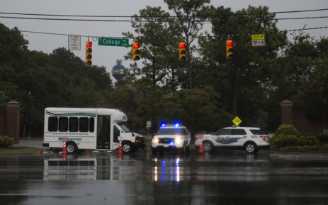 Police block a road as rain from Hurricane Florence falls in Wilmington, North Carolina on 13 September 2018. Hurricane Florence edged closer to the east coast of the US on Thursday, with tropical-force winds and rain already lashing barrier islands just off the North Carolina mainland. Picture: AFP.