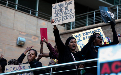 Demonstrators gather near the Johannesburg Stock Exchange in Sandton on 13 September 2019 in protest against gender-based violence. Picture: Kayleen Morgan/EWN