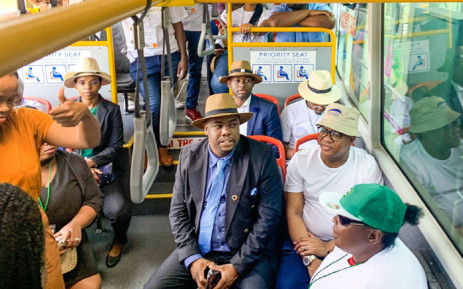 Transport Minister Fikile Mbalula (in brown bucket hat and white T-shirt) uses a bus to showcase Tshwane's integrated transport systems on 25 October 2019. Picture: @MbalulaFikile/Twitter