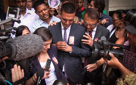The Hindocha family gives an emotional statement on the steps of the Western Cape High Court shortly after Shrien Dewani was acquitted and discharged on 8 December 2014. Picture: Aletta Gardner/EWN.