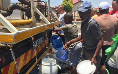 FILE: Coronationville residents collect water from a tanker. Picture: EWN
