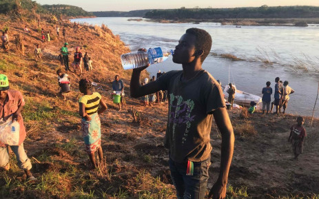 FILE: A man from a village close to the edge of the Buzi River drinks water after receiving food and water from relief workers after Cyclone Idai hit Mozambique. Picture: Christa Eybers/EWN.