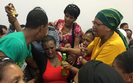 Beatrice Adams (in red), the mother of the murdered Michaela Williams is helped in the Wynberg Magistrates Court after suffering a panic attack on 13 January 2020. Picture: Lauren Isaacs/EWN
