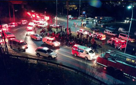 Dozens of emergency vehicles are on the scene and emergency workers are still trying to rescue those trapped inside the train. Picture: @ER24EMS.
