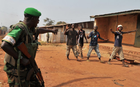 Rwanda soldier from the African-led International Support Mission to the Central African Republic (MISCA), gestures as he patrols on 22 January, 2014 in the Pk 13 district, north of Bangui, after after an attack by anti-Balaka fighters. Picture: AFP.
