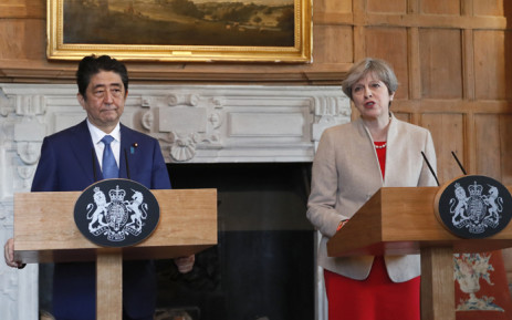 Britain's Prime Minister Theresa May delivers a statement alongside Japan's Prime Minister Shinzo Abe at Chequers, the prime minister's official country residence, near Ellesborough, northwest of London, on 28 April, 2017. Picture: AFP.