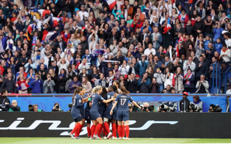 France's forward Eugenie Le Sommer (hidden) celebrates with teammates after scoring a goal during the France 2019 Women's World Cup Group A football match between France and South Korea, on 7 June 2019, at the Parc des Princes stadium, in Paris. Picture: AFP