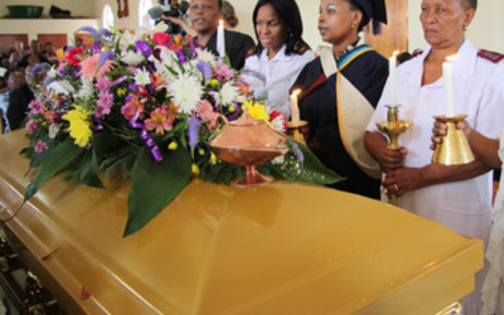Gloria Sekwena's colleagues stand next to her coffin at the funeral in Kagiso. Picture: Taurai Maduna/EWN