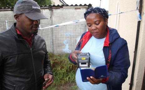 IEC Election official scans resident's barcoded I.D allowing them to start their voting process at 2019 Langa Red Cross Society voting Station 03. Picture: Bertram Malgas