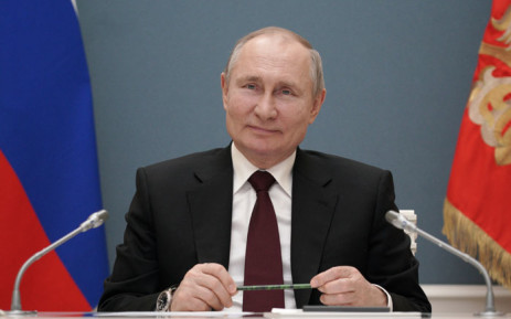 Russian President Vladimir Putin participates via video link in a ceremony launching a gold processing facility in Kyrgyzstan, in Moscow on 17 March 2021. Picture: Alexei Druzhinin/AFP