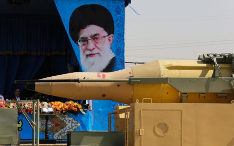 An Iranian military truck passes by a huge poster of the Iranian supreme leader Ayatollah Ali Khamenei, as it carries a long-range Ghadr-F ballistic missile during the annual military parade marking the Iraqi invasion in 1980, which led to a eight-year-long war (1980-1988) in Tehran, Iran, 22 September 2014. Picture: EPA.