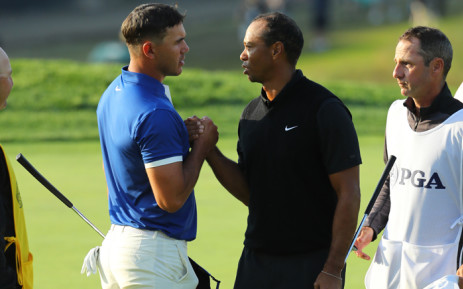 FILE: In this file photo taken on 16 May 2019, Brooks Koepka of the United States and Tiger Woods of the United States shake hands on the 18th green during the second round of the 2019 PGA Championship at the Bethpage Black course in Farmingdale, New York. Picture: AFP