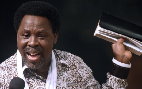 FILE: Nigerian pastor TB Joshua speaks during a New Year's memorial service for the South African relatives of those killed in a building collapse at his Synagogue Church of All Nations on 31 December 2014. Picture: AFP.