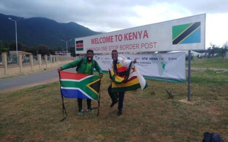 Botha Msila and his Zimbabwe travelling partner Alvin Zhakata at the Kenyan border. Picture: Botha Msila/Twitter.