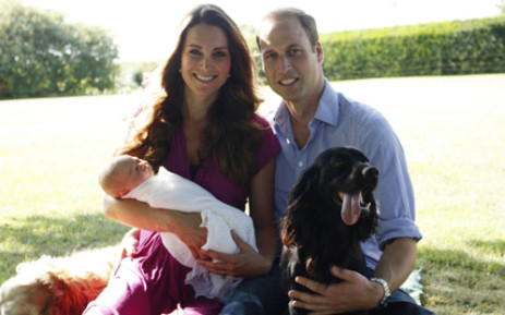 Prince William and his wife Catherine, with their newborn baby boy, Prince George of Cambridge, Tilly the retriever (L), a Middleton family pet and Lupo, the couple's cocker spaniel (R) at the Middleton family home in Bucklebury, Berkshire, in early August, 2013. Picture: AFP.
