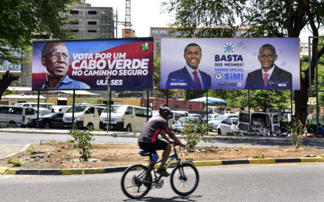 A man rides past electoral campaign posters in the streets of Praia, on April 17, 2021, on the eve of the parliamentary elections. Picture: AFP
