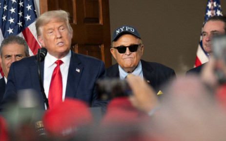FILE: Former President Donald Trump's personal lawyer Rudy Giuliani listens as Trump delivers remarks to the City of New York Police Benevolent Association at the Trump National Golf Club in Bedminster, NJ, on 14 August 2020. Picture: JIM WATSON/AFP