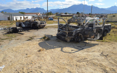A municipal building was partially damaged when it was torched, while two municipal vehicles were gutted during Thembalethu protests. Picture: Xolani Koyana/EWN.