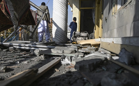 People inspect a damaged house after several rockets land at Khair Khana, north west of Kabul on 21 November 2020. A series of loud explosions shook central Kabul on 21 November, including several rockets that landed near the heavily fortified Green Zone where many embassies and international firms are based, officials said. Picture: AFP.
