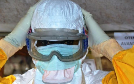 FILE: A health worker wearing a protective suit. Picture: AFP.