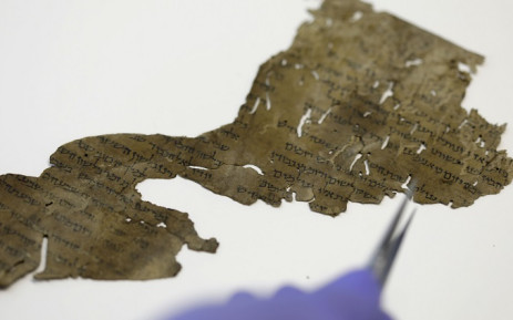 A conservator of the Israel Antiquities Authority (IAA) shows fragments of the Dead Sea Scrolls at their laboratory in Jerusalem on 2 June 2020. Picture: AFP