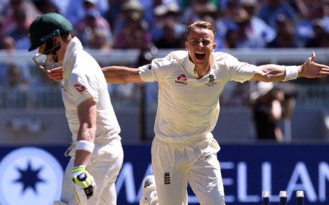 England's Tom Curran (R) celebrates bowling Australia's batsman Steve Smith (L) on the second day of the fourth Ashes cricket Test match at the MCG in Melbourne on 27 December, 2017.  Picture: AFP